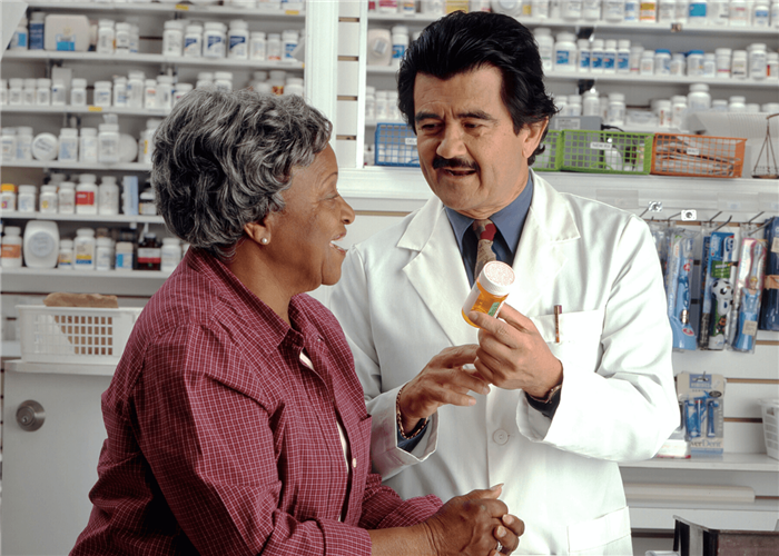 a patient consulting with her pharmacist